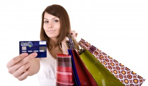 Woman with shopping bags holding Metco Card