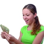 girl in green shirt holding money
