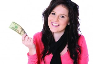 girl holding 20-dollar bill