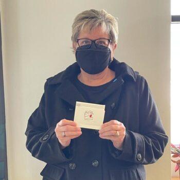 Julie O. holding gift card